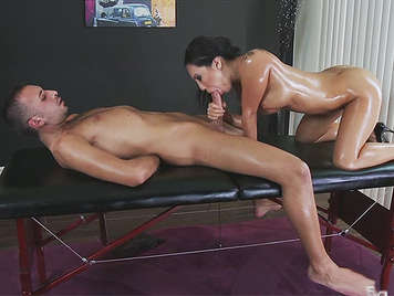 Exuberant Asian babe covered in oil, sucking his cock, to his Massage therapist