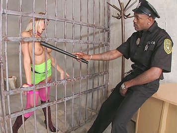 black cop with a big cock fucking a blonde slut in jail