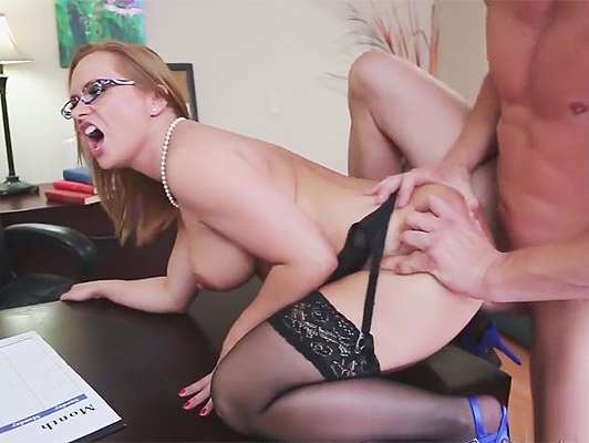 Mature busty secretary fucked on all fours by her boss at the office table