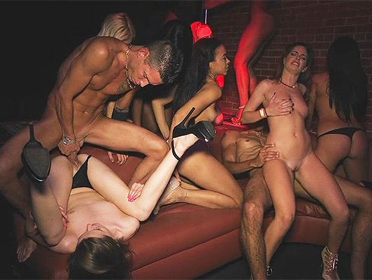 Interracial sex party in a dark nightclub