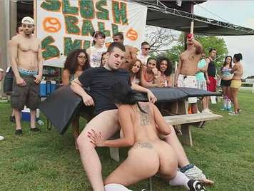 Orgy at the football field with barbecue hot dog