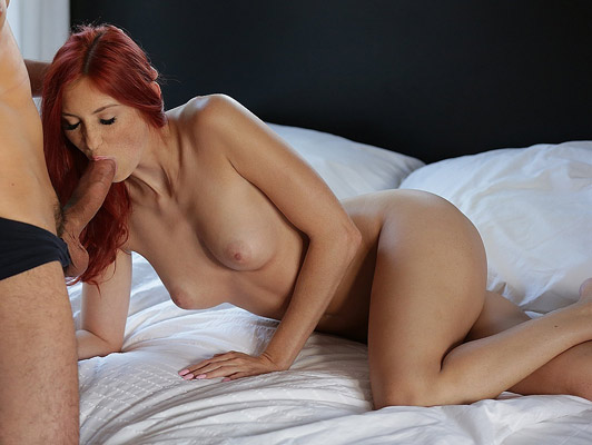 Beautiful redhead girl with natural tits sucking cock fucking with her lover