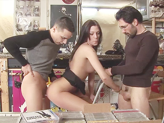 Trio anal sex in public, a cute brunette sodomized by two huge cocks in a music store
