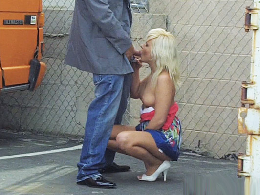 Voyeur with a camera catches a blonde sucking his cock to a trucker who fucks her from behind like a bitch