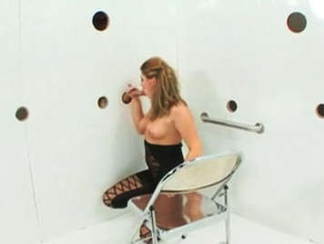 Blonde busty in a box of glory holes, full of hard cocks to suck and fuck