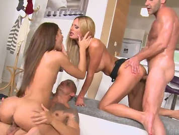 Foursome with a busty blonde and a slim brunette
