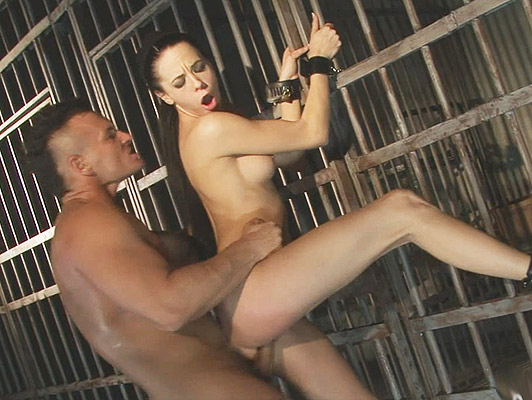 Extreme sex fucking a pretty brunette girl with big ass from behind tied to a cage