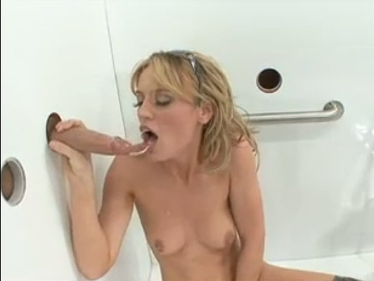Horny blonde, chasing dicks coming out of glory holes in the wall