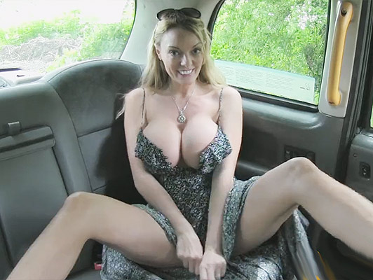 Mature with a cock between her huge tits fucking hard in a taxi