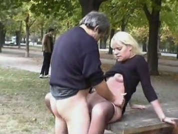 Exhibitionist couple practicing hard sex in the park in front of a group of voyeurs