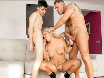 Lustful blonde Colombian mature with big tits fucked by two huge cocks