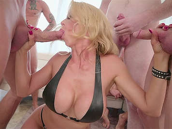 Bukkake with a housewife with big tits sucking 5 cocks at once