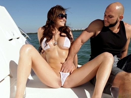 Busty lusty girl with a spectacular body in bikini covered with oil fucked on a boat
