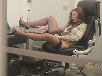 Sexy secretary masturbating in the office