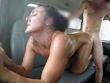 Fucking in the car a pretty girl with tanned skin and big natural tits