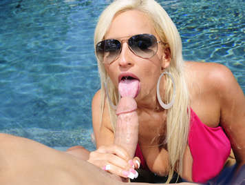 Blonde milf in bikini with big tits sucking cock in the pool
