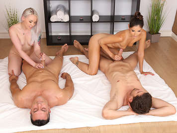 Sex quartet with a brunette and a blonde professional masseurs