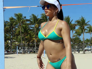 Busty Latina with big ass on the beach plays volleyball and wants a cock fucking her pussy