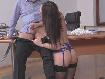 Sensual young obedient secretary kneeling in lingerie sucking her boss's cock