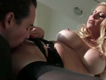Busty blonde in black lingerie gets very hot