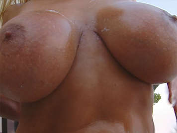 Busty MILF wants milk between her tits as she like a bitch squirting