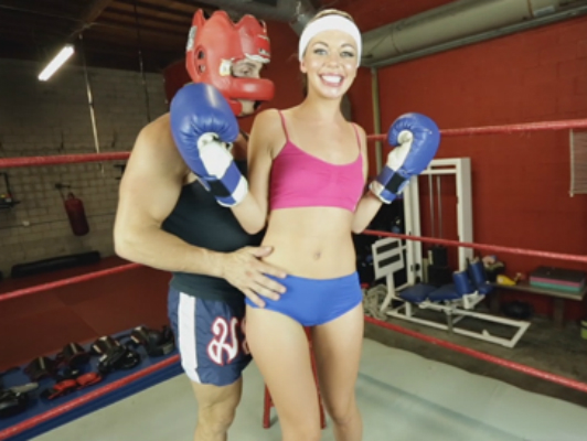 This sport girl receives boxing classes