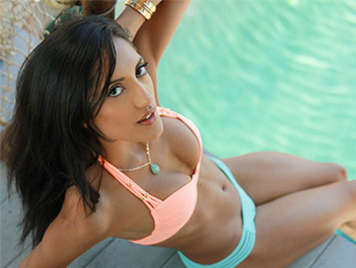Latin brunette in bikini having sex in pool