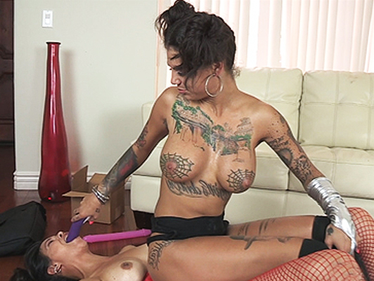 Two tattooed lesbian friends in a porn video with extreme sex