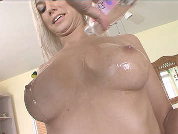 Beautiful blonde with big breasts smeared in oil, fucking is cumshot between her boobs