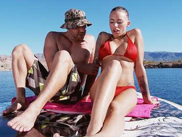 Tattooed brunette having rough sex in bikini on the beach