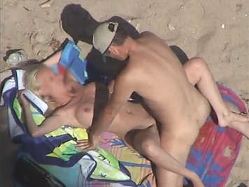 Voyeur filming a couple, fucking on the beach she is a blonde with big tits