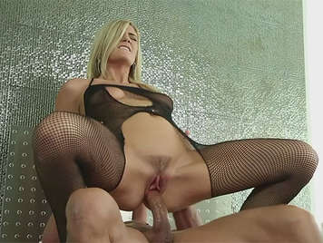 Sexy and beautiful blonde in a grid bodysuit, legs open fucking a huge cock, getting his cock to the balls in her hairy pussy moans like a slut squirting while moving their hips and masturbate her clit