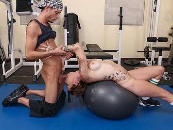 Busty tattooed girl fucking and sucking cock fucked in gym on a huge ball, with an embedded cock in her pussy shaved, he runs between her beautiful tits