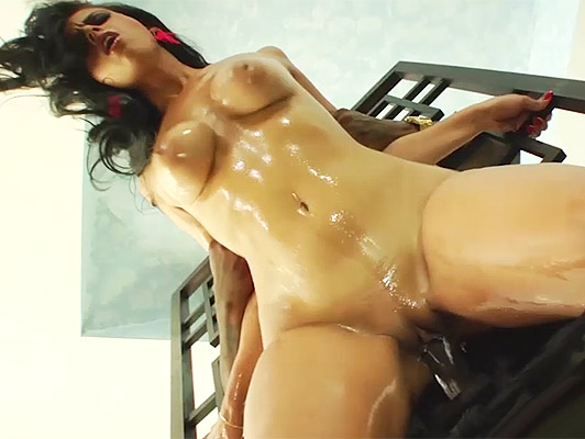 Busty brunette latina with a body covered with oil body fucked by a black guy with a huge cock
