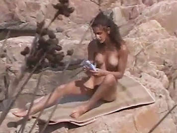 Voyeur filming a girl who is masturbaing on the beach and has just fucking with her and cums it in her mouth