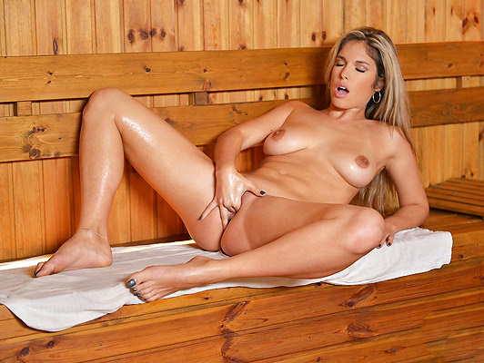 Busty blonde masturbating in a sauna gets a wet orgasm
