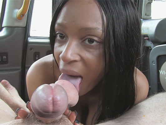 A busty ebony goddess doing a blowjob to a taxi driver, sucking balls and licking his asshole