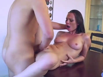 Fucking on the table with busty girlfriend