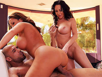 Threesome of sex with two horny busty milfs