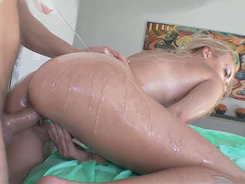 Assed blonde, with the body covered with oil fucked hard by behind