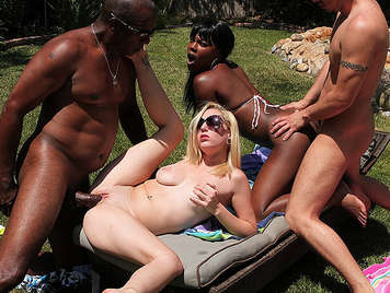 Interracial swingers party in the pool with a busty blonde and a black girl with a powerful ass