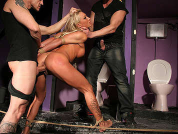 Hard anal sex and humiliation to a blonde fucked by two nightclub keepers in the bathroom