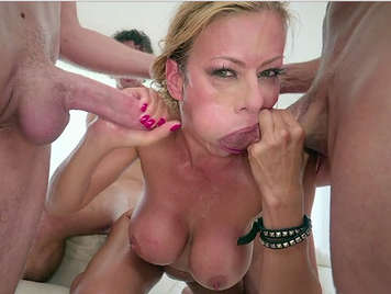 Mature blonde with big tits and deep throat in a dirty bukkake scene