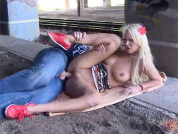 Sex in public fucking a blonde with big tits under a dirty bridge of the train station