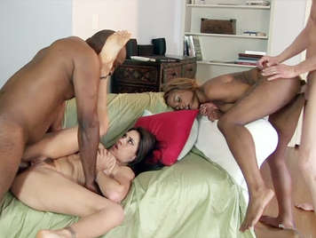 Double fucked in an interracial orgy of singles