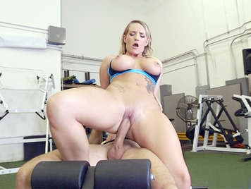 Mature blonde with big tits riding a cock in the gym