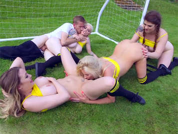 Sex with four busty girls on the football field