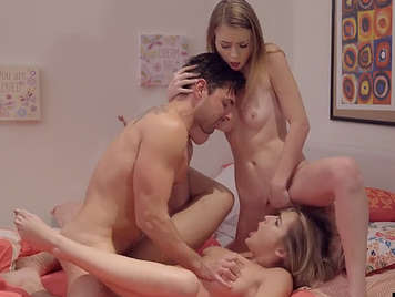 Two horny young woman in a threesome are hard sex.
