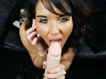 Keeping The telephone Conversation Going while she makes a blowjob