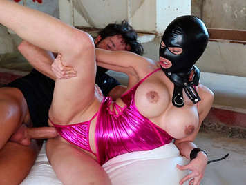 Spanish porn fucking an exuberant submissive sex slave with big boobs hooded in an abandoned factory